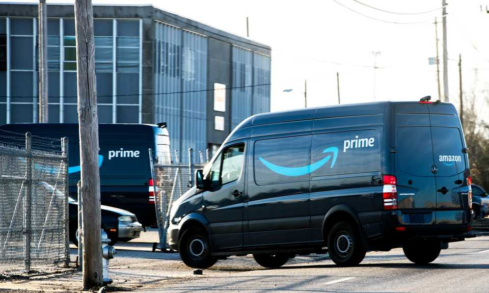 <strong>Amazon Prime delivery vans have shown up around Memphis this fall. Several lined the street at Amazon&rsquo;s temporary distribution center at 109 W. McLemore south of Downtown Monday, Dec. 17.</strong>&nbsp;(Houston Cofield/Daily Memphian)