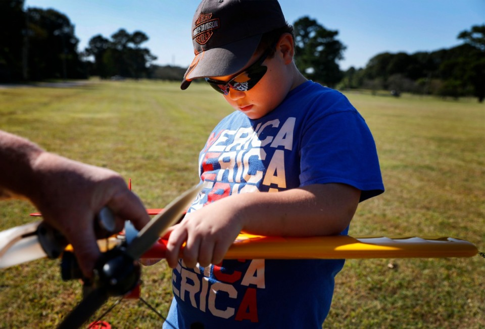 <strong>Taylor Pugh, 8, helps his grandfather as they gas up a Ringmaster airplane on Thursday, Oct. 1, 2020 at Audubon Park.</strong> (Mark Weber/The Daily Memphian)