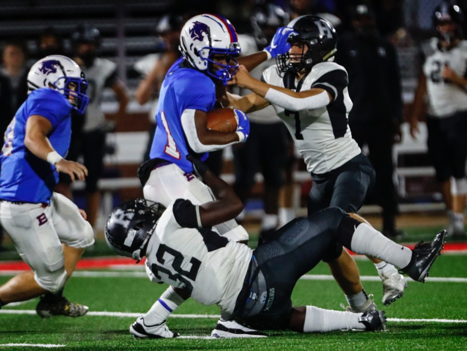 <strong>Bartlett&rsquo;s Orlando Moore Jr. (left) is tackled by the Houston defense Friday.</strong> (Mark Weber/The Daily Memphian)