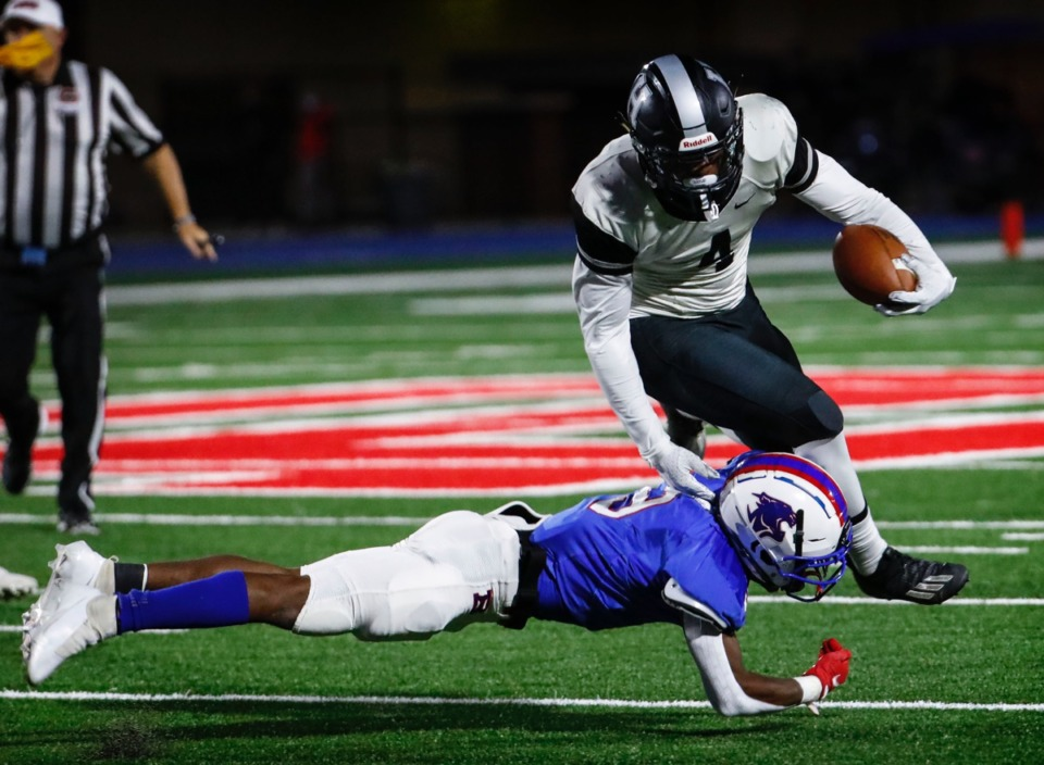 <strong>Houston running back Pierre Seals (top) is tackled by Bartlett defender Thomas Jones (bottom) Friday.</strong> (Mark Weber/The Daily Memphian)