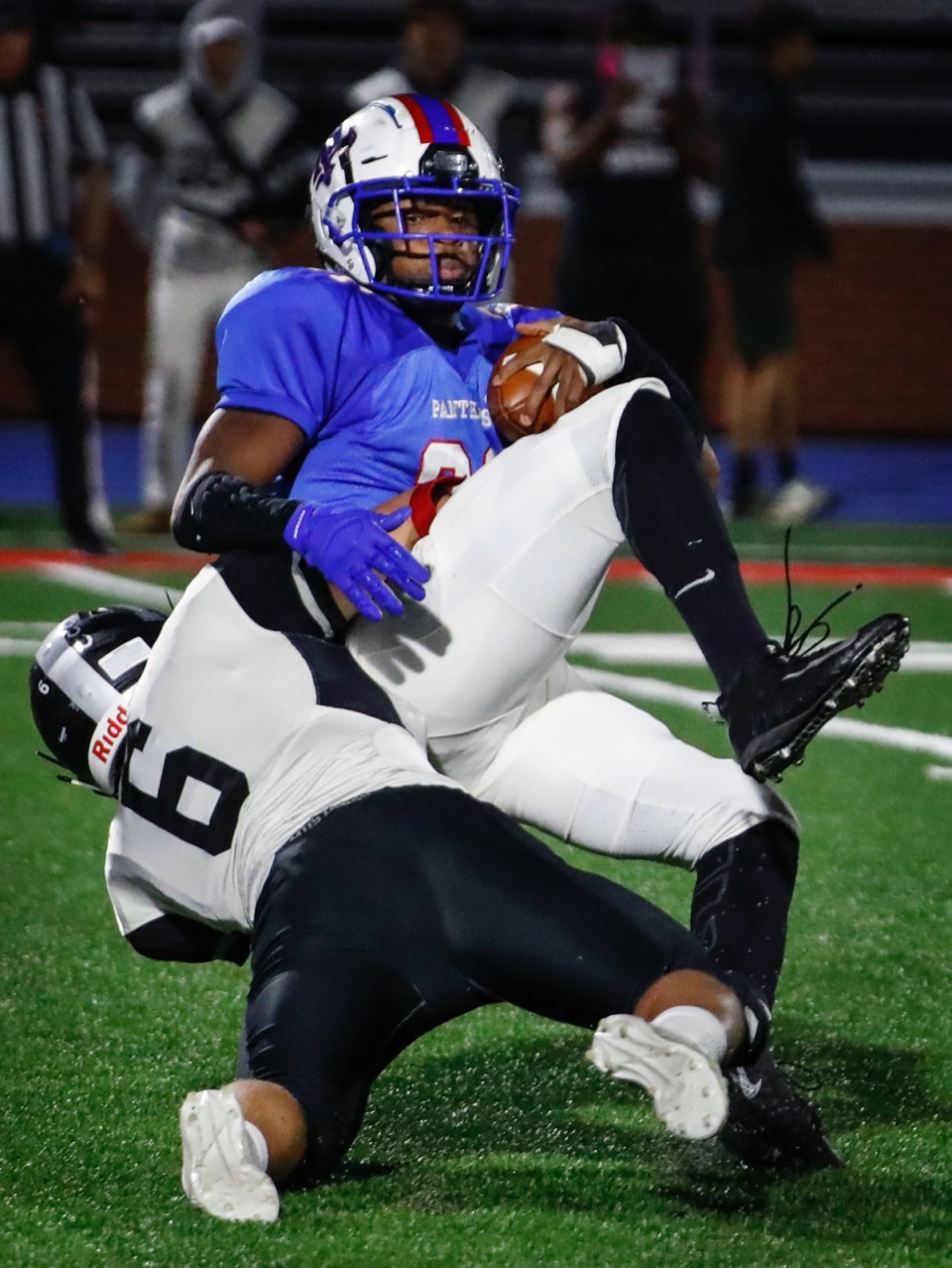 <strong>Houston defender Brady Weatherly (bottom) tackles Bartlett running back Robert Giaimo (top) in the backfield Friday.</strong> (Mark Weber/The Daily Memphian)