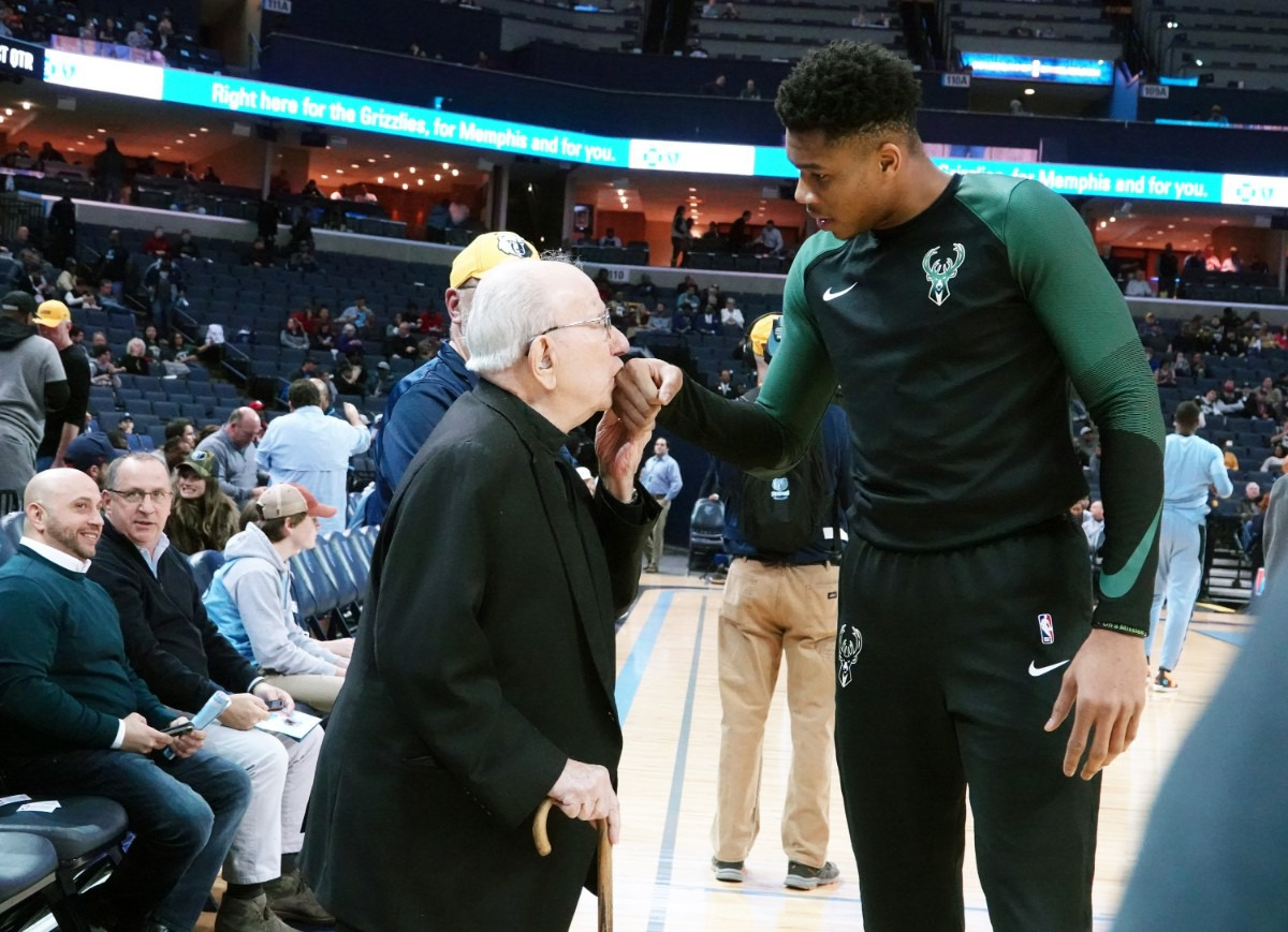 <strong>Memphis Greek Orthodox Priest, 93-year-old Father Nicholas Vieron, kissed hand of Milwaukee Bucks Giannis Antetokounmpo, who was born in Greece, during a blessing before the start of the of the the game at FedEx Forum, Jan. 16, 2019. </strong>(Courtesy Karen Pulfer Focht)
