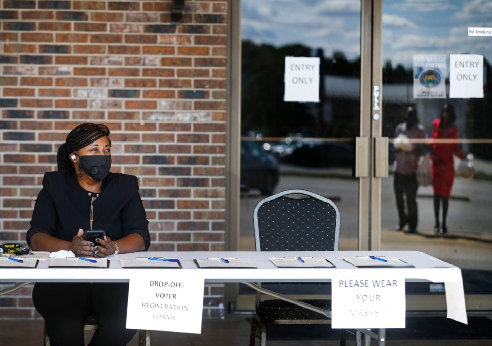 <strong>Karen Collier staffs a voter registration table on Friday, Oct. 2, 2020 at Southbrook Town Centre in Whitehaven.</strong> (Mark Weber/The Daily Memphian)