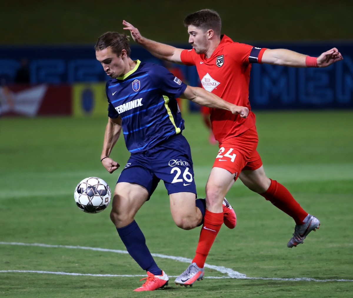 <strong>Memphis 901 FC forward Cal Jennings (26) fights off a Birmingham Legion defender on his way to his second of three goal during a Oct. 3, 2020 game at AutoZone Park.</strong> (Patrick Lantrip/Daily Memphian)