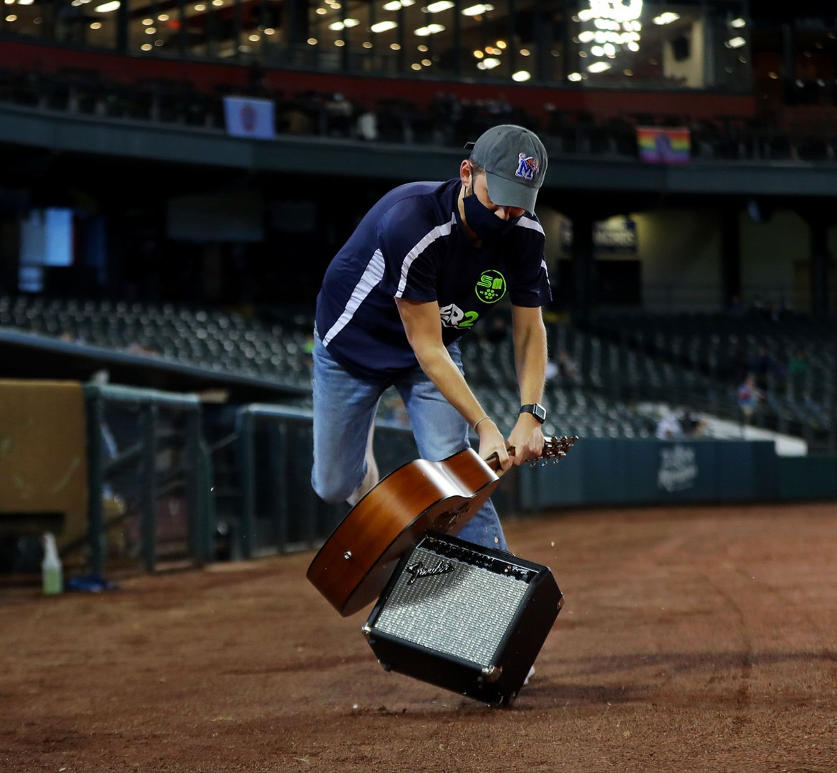 <strong>West Tennessee teacher of the year Daniel Warner smashes the ceremonial guitar during Memphis 901 FC's last home game of the year Oct. 3, 2020.</strong> (Patrick Lantrip/Daily Memphian)