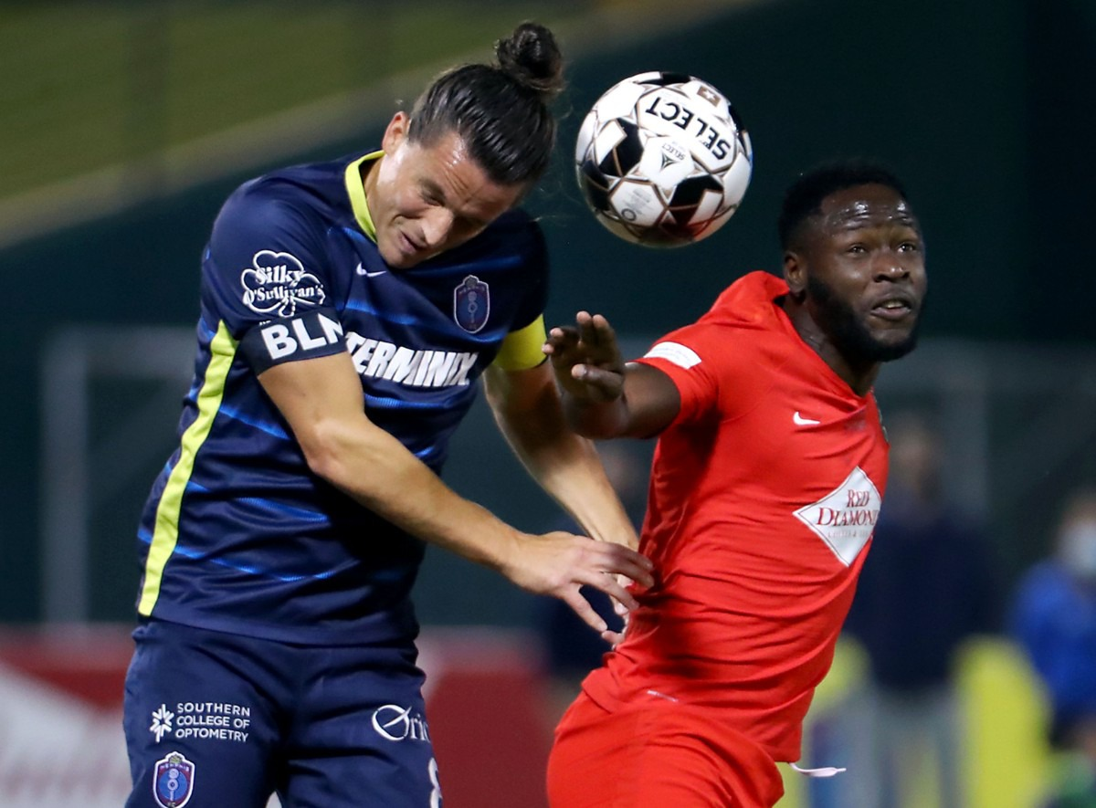 <strong>Memphis 901 FC captain Marc Burch (8) goes up for a header during a Oct. 3, 2020 home game against the Birmingham Legion.</strong> (Patrick Lantrip/Daily Memphian)
