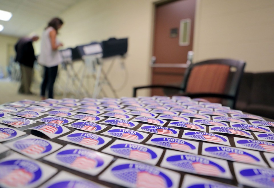 <strong>An election worker took the time to arrange the &ldquo;I voted&rdquo; stickers at Second Baptist Church on Walnut Grove into a hypnotic pattern while nearby residents early vote in the background Sept. 20, 2019.</strong> (Patrick Lantrip/Daily Memphian)