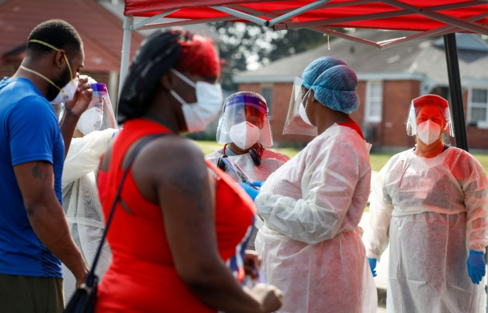 <strong>Christ Community Health Services staff members collect nasal swabs during a walk-up coronavirus testing on September 17, 2020 at Orange Mound Health Center.</strong> (Mark Weber/The Daily Memphian)