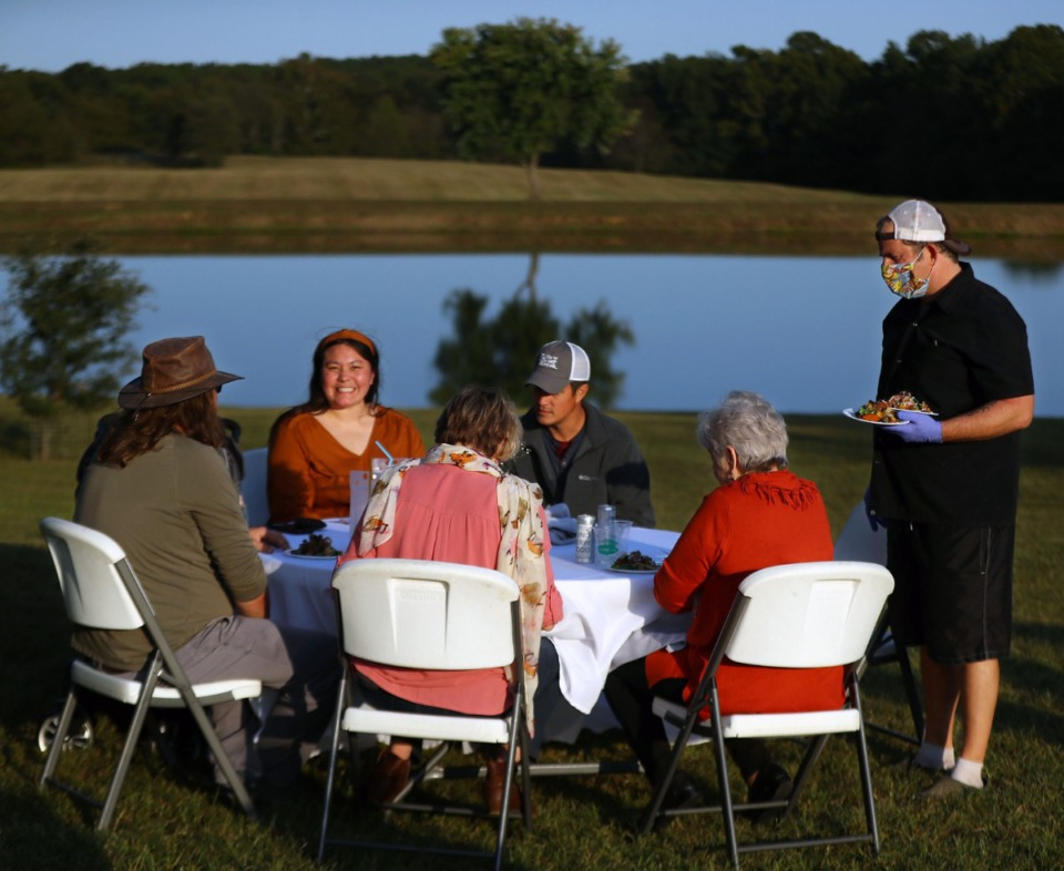 <strong>Spencer McMillin passes out food during a dinner to benefit local restaurants held on a farm in Williston, Tennessee Oct. 3, 2020.</strong> (Patrick Lantrip/Daily Memphian)