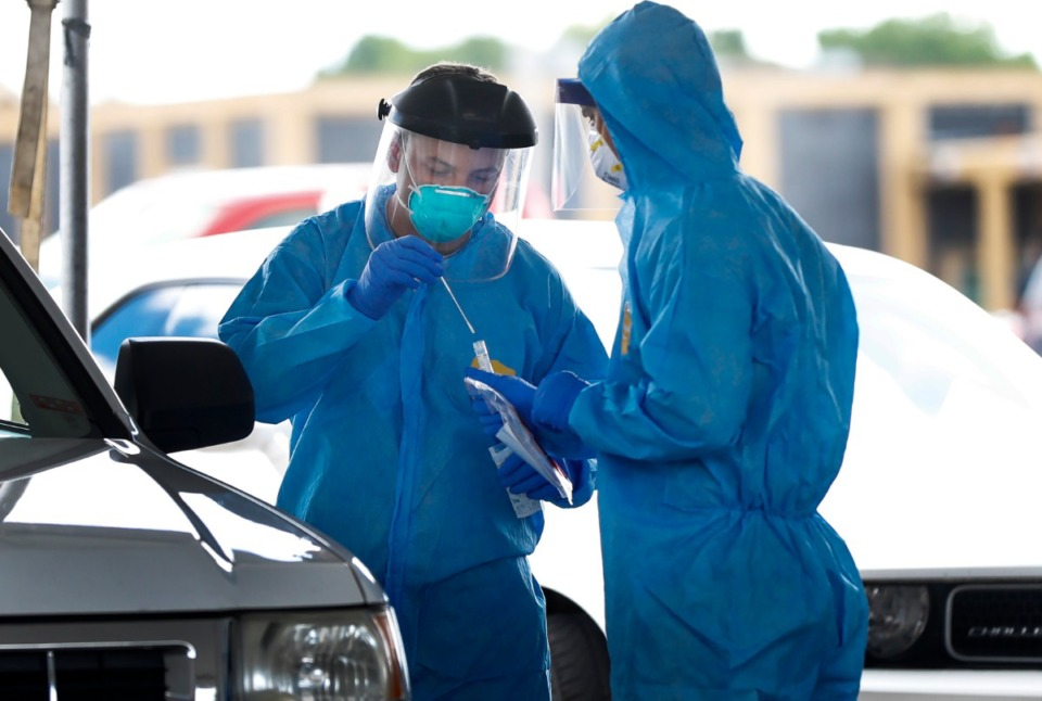 <strong>National Guard medics and University of Tennessee Health Science Center staff collect nasal swabs as hundreds of Memphians line up for COVID-19 testing at the Christ Community testing site in Hickory Hill on May 6, 2020</strong>. (Mark Weber/Daily Memphian file)