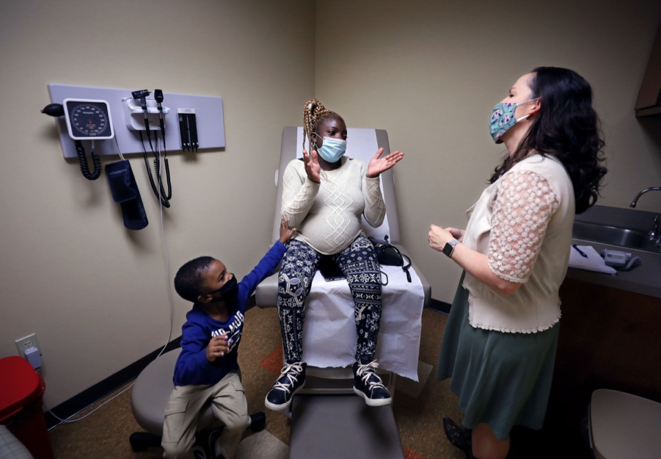 <strong>Tramaine Whitten tried to get his mother Tiffany's attention during a Sept. 30 checkup with Regional One midwife Meghan Madea</strong>. (Patrick Lantrip/Daily Memphian)