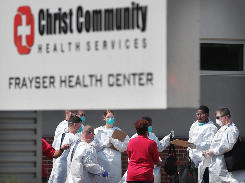 <strong>Christ Community staff, medical technicians and National Guard medics prepare to start a long day of COVID-19 testing as hundreds of Memphians line up at the Christ Community testing site in Frayser on April 25, 2020</strong>. (Jim Weber/Daily Memphian file)