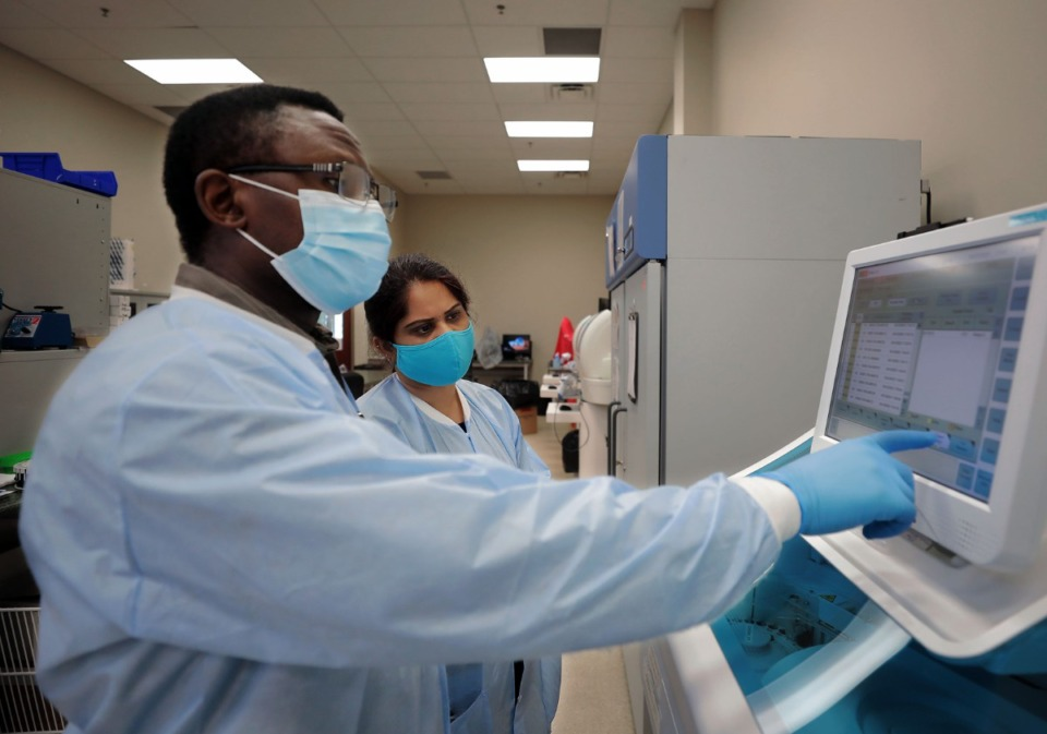 <strong>Toh Gang (left) and Lakshmi Nellore process samples at Poplar Healthcare Sept. 22, 2020</strong>. (Patrick Lantrip/Daily Memphian)
