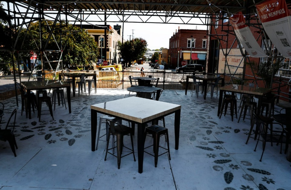<strong>The outside dining on Huling at South Main consists of a 42-by-50-foot stage set-up that extends off the side platform of Puck Food Hall and provides properly distanced seating for 50.</strong> (Mark Weber/Daily Memphian)