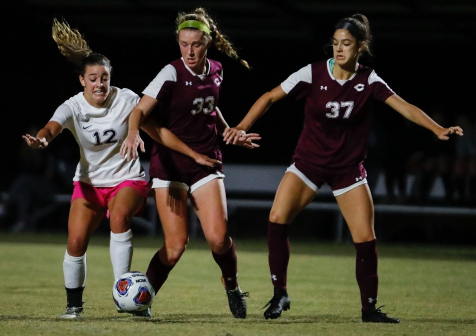 <strong>Houston midfielder Parker Gelinas (left) battles Collierville defenders Abby Johnson (middle) and Ellison Suhoza (right) on Tuesday, Oct. 5, 2020.</strong> (Mark Weber/The Daily Memphian)