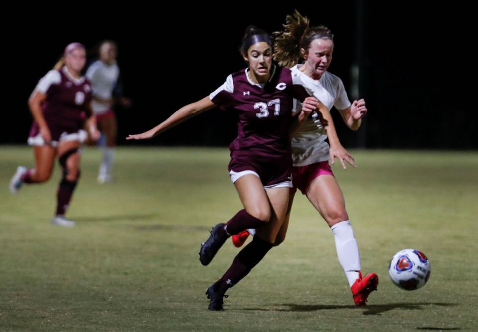 <strong>Collierville defender Ellison Suhoza battles Houston forward Ruby Langford (right) on Tuesday, Oct. 5, 2020.</strong> (Mark Weber/The Daily Memphian)