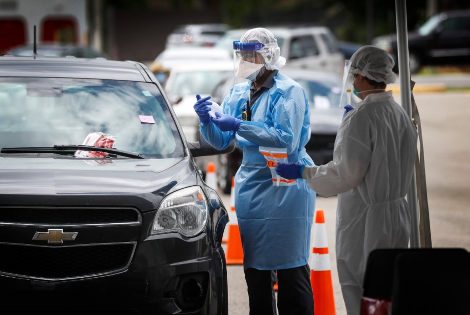 <strong>Christ Community Health Services medical staff collect nasal swabs as hundreds of Memphians line up for COVID-19 testing at its site in Hickory Hill on Tuesday, May 19, 2020</strong>. (Mark Weber/Daily Memphian)