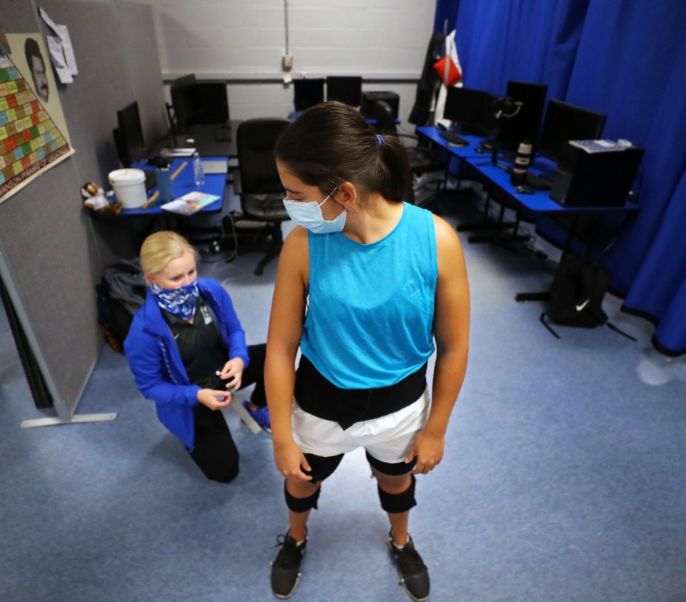 <strong>Daily Memphian reporter Danielle Lerner gets fitted with spherical markers that will be used to create a 3D model of her body.</strong> (Patrick Lantrip/Daily Memphian)