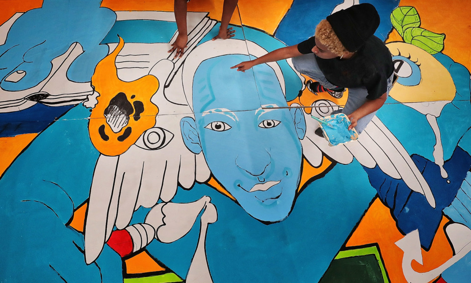 <strong>Artist Amber George directs Arkealia Rayford on how to blend the different panels of a mural they are working on during an afterschool program on Dec. 18, 2018, for Melrose High School students at The Collective on Lamar Avenue.</strong> (Jim Weber/Daily Memphian)