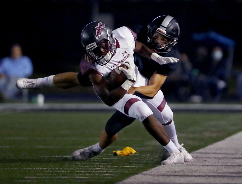 <strong>Collierville&rsquo;s John Hampton III (3) gets dragged out of bounds Oct. 9 by a Houston defender.</strong> (Patrick Lantrip/Daily Memphian)