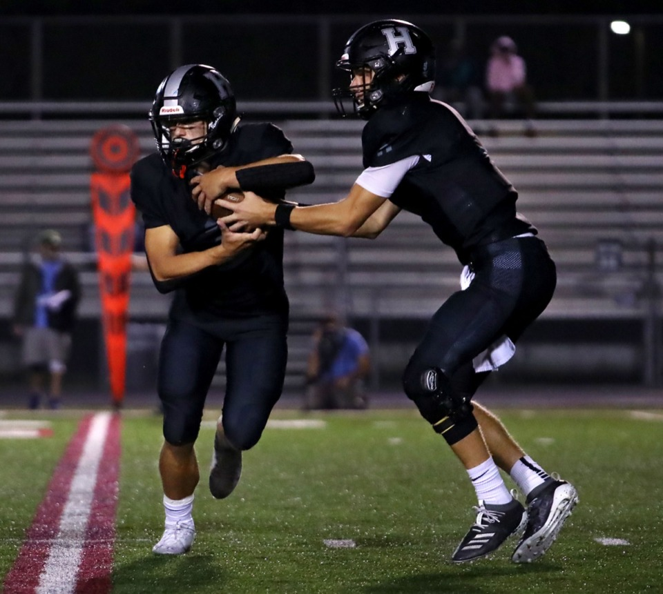 <strong>Houston quarterback Gray Nischwitz (5) pulls the ball back from running back Ben Stegall (2) for a play against Collierville Oct. 9.</strong> (Patrick Lantrip/Daily Memphian)