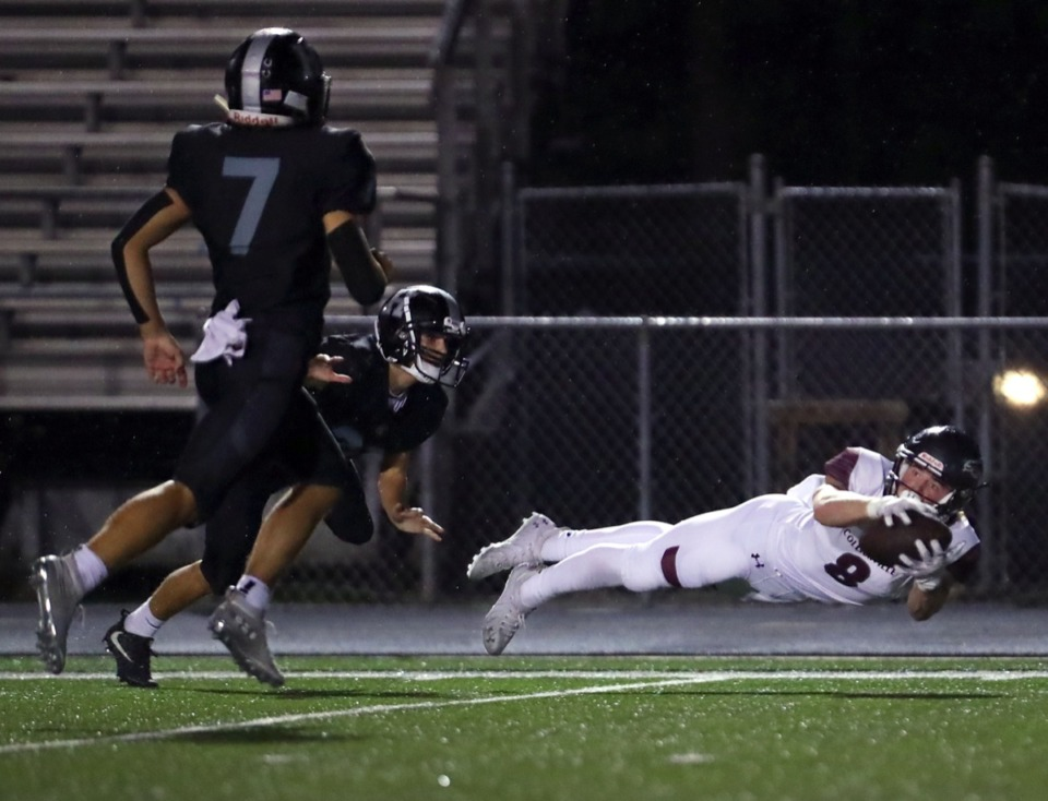 <strong>Collierville receiver Tyler Collier (8) makes a diving catch for a first down against Houston Oct. 9.</strong> (Patrick Lantrip/Daily Memphian)