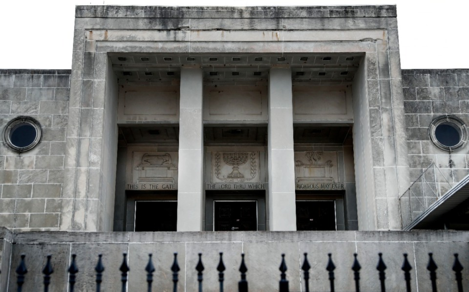 <strong>Jewish symbols adorn entrances to the former Baron Hirsch Synagogue.</strong> <strong>The three-story, gray limestone building with some marble trim has been headquarters for the 75-church COGIC jurisdiction and also has housed the Gethsemane Garden COGIC congregation.</strong> (Mark Weber/Daily Memphian)