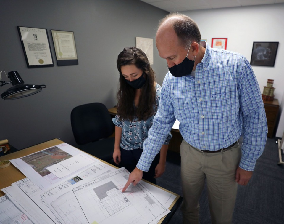 <strong>Pickering Firm architect Tom Moisan goes over plans for Whitehaven Plaza with Irene Ball at their new East Memphis office on Thursday, Oct. 1.</strong> (Patrick Lantrip/Daily Memphian)