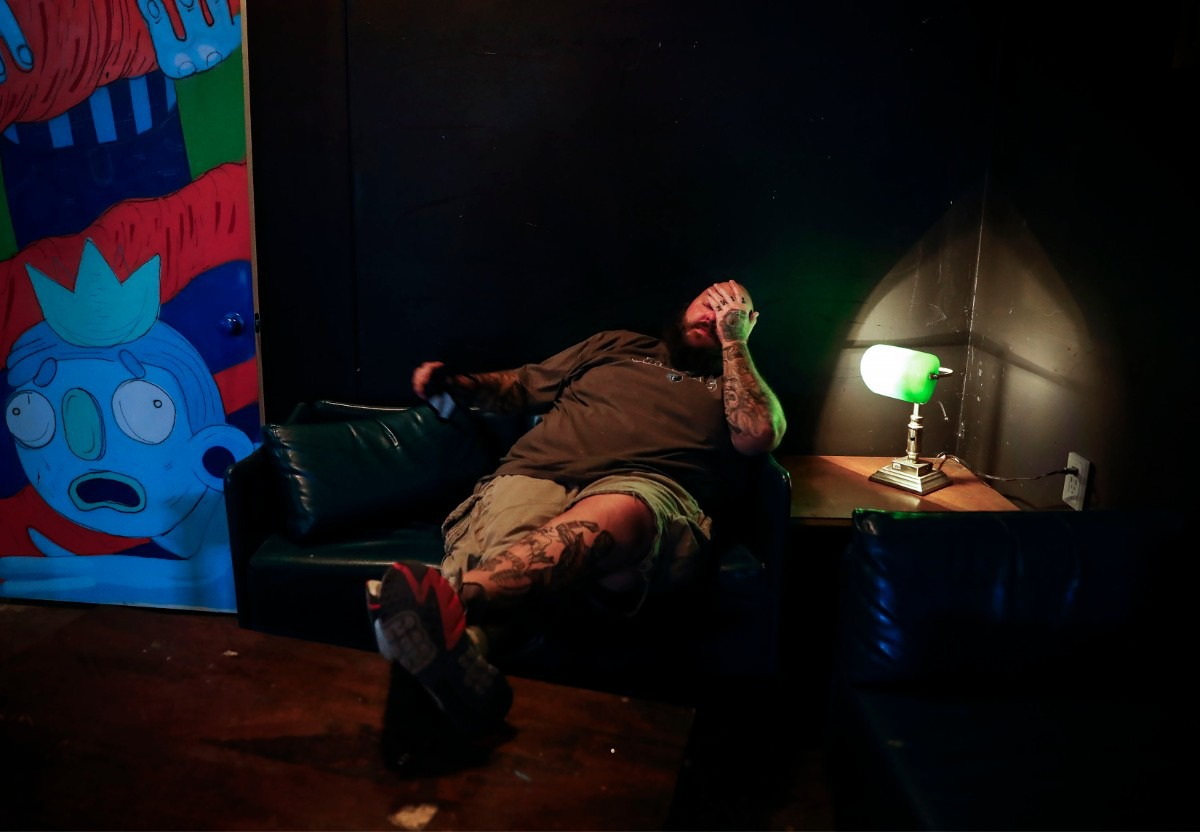"""<strong>Hi-Tone Cafe owner Brian """"Skinny"""" McCabe takes a moment to himself on Oct. 7, 2020, at his new location on Cleveland. McCabe has taken a long road to reopening the popular Midtown music venue and bar since the pandemic hit in March</strong>. (Mark Weber/The Daily Memphian)"""