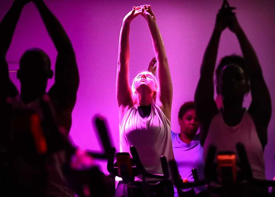<strong>Randell Jones (left), Allison Welch and Courtney Jones stretch while warming down from a workout led by instructor Sidney Johnson at a Spincult. The cycling studio, located in the Medical District, opened in August.</strong>&nbsp;(Jim Weber/Daily Memphian)