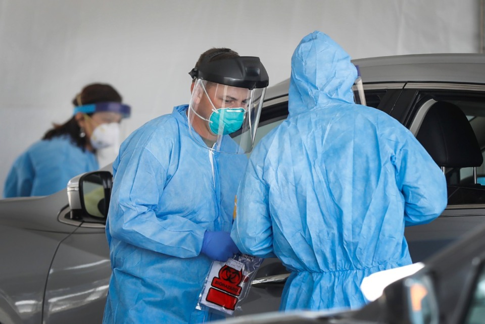 <strong>National Guard medics and University of Tennessee Health Science Center staff collect nasal swabs as hundreds of Memphians line up for COVID-19 testing at the Christ Community testing site in Hickory Hill on Wednesday, May 6, 2020</strong>. (Mark Weber/Daily Memphian)