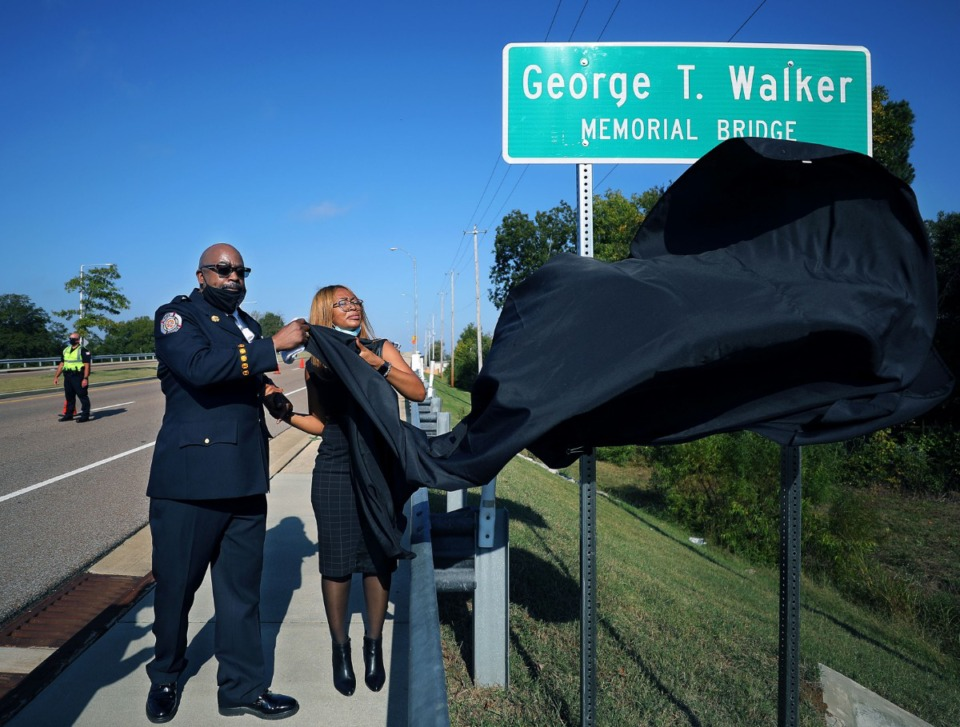 <strong>Rickey Walker unveils the memorial sign that names a bridge in Collierville after his father, George T. Walker Oct. 12, 2020.</strong> (Patrick Lantrip/Daily Memphian)