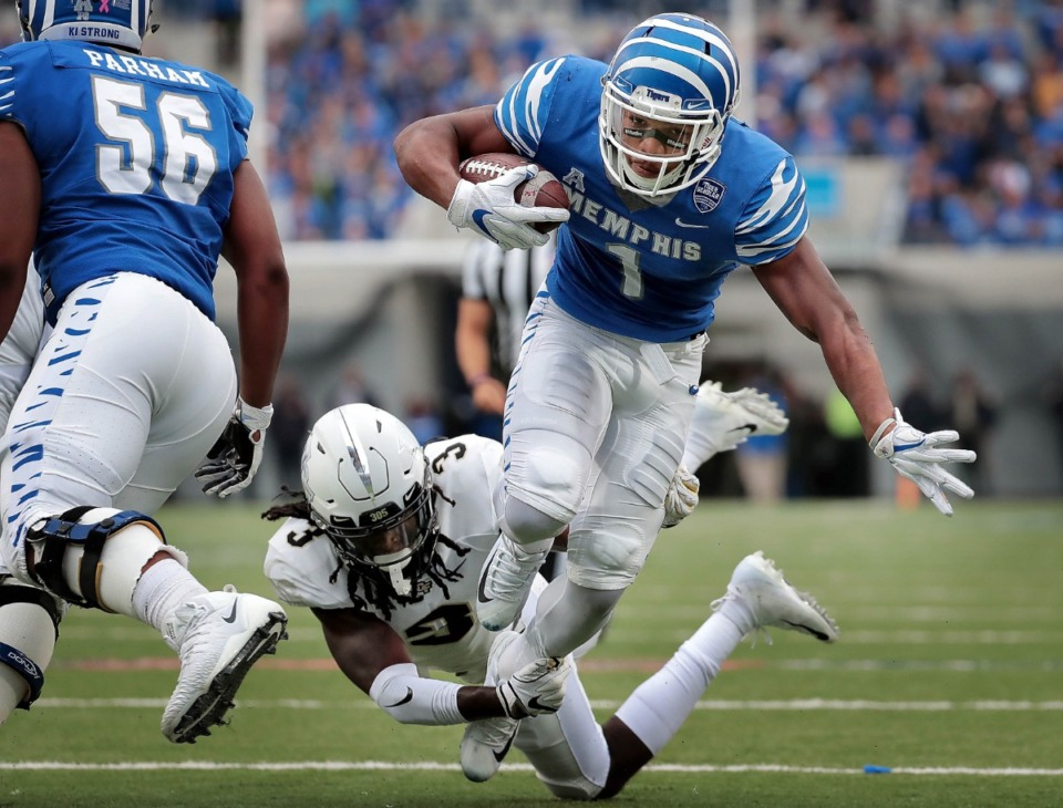 <strong>University of Memphis running back Tony Pollard (1) is taken down by Antwan Collier (3) just shy of the endzone during the Tigers disappointing 31-30 loss to UCF at the Liberty Bowl Memorial Stadium on Oct. 13, 2018.</strong> (Jim Weber/Daily Memphian file)