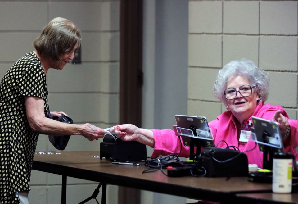 <strong>Jane Fennell directs an early voter where to go next at the White Station Church of Christ polling location in East Memphis Sept. 20, 2019.</strong>&nbsp;<strong>The County Commission rejected a&nbsp;$5.8 million contract for a new voting system Oct. 12.</strong> (Patrick Lantrip/Daily Memphian)
