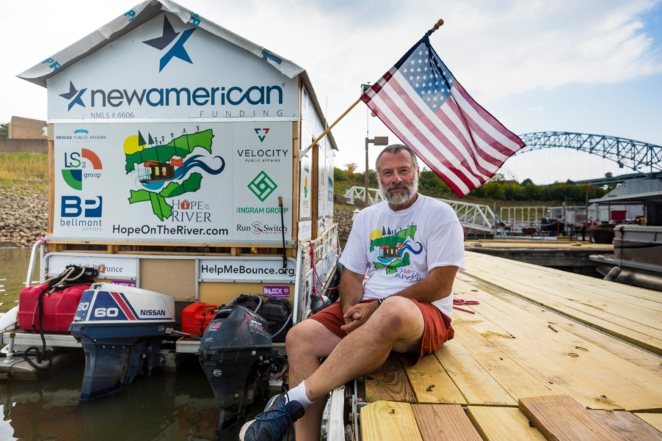 <strong>Spare Key Executive Director Erich Mische floats on his pontoon boat on Oct. 12, 2020, near Mud Island. He is sailing from Minneapolis to Baton Rouge to raise funds and awareness for his nonprofit.</strong> (Ziggy Mack/Special to The Daily Memphian)