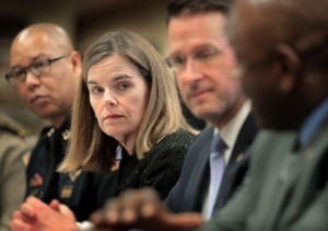 <strong>Shelby County District Attorney Amy Weirich (center) has asked Memphis Police Director Michael Rallings (left) to begin sending all confirmed cases of excessive use of force to her office to determine if criminal charges are merited against the officers. </strong>(Daily Memphian file)