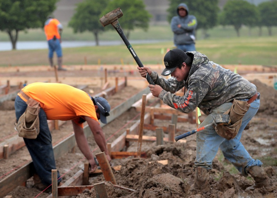 <strong>Two construction workers build cement molds at the new Bartlett First Responders monument, a large municipal project that recently started construction.</strong> (Daily Memphian file)