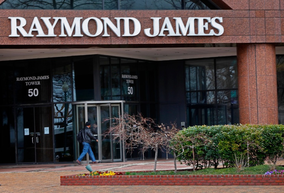 <strong>Under a multiyear contract, 13 University of Memphis students were recruited and trained early this fall and are working at Raymond James. Over the next two months, 20 more will join the project.</strong> (Daily Memphian file)