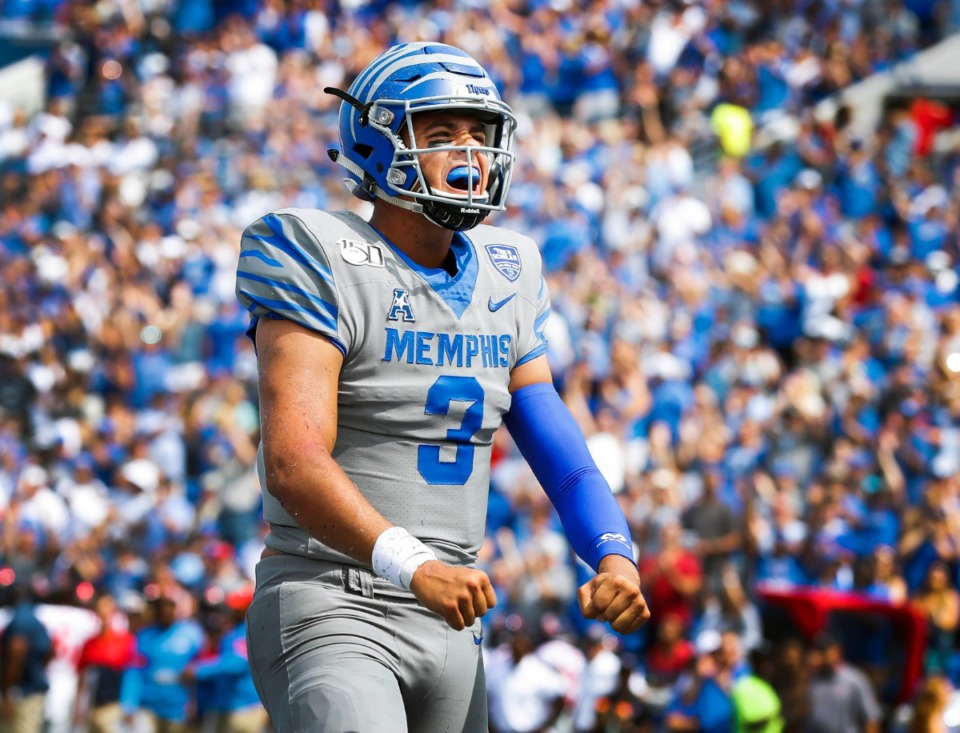 <strong>Memphis quarterback Brady White celebrates a touchdown against the Ole Miss defense during action in their NCAA football game at the Liberty Bowl Memorial Stadium Saturday, August 31, 2019.</strong>