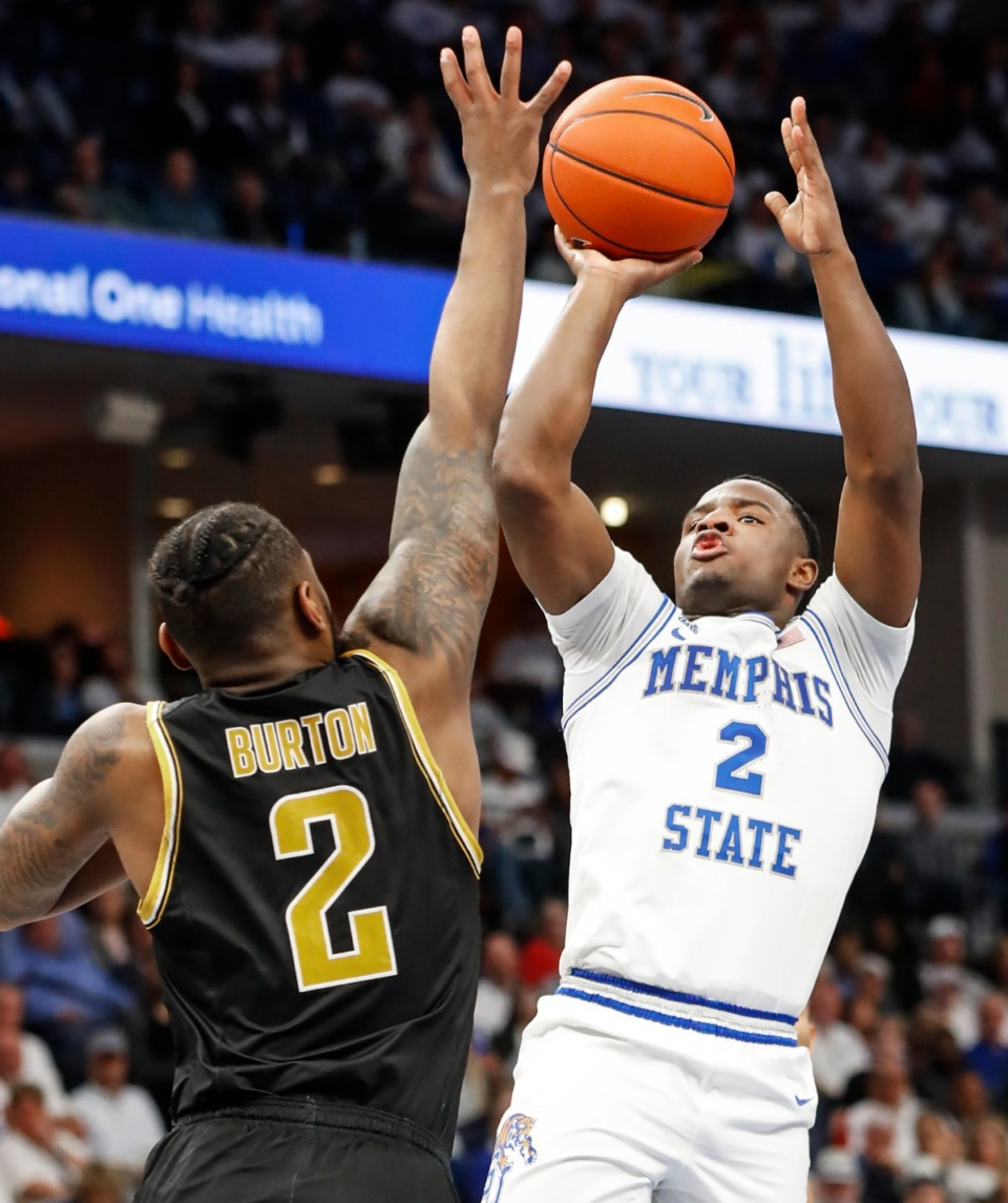 <strong>Memphis guard Alex Lomax (right) hits a shot in front of Wichita State defender Jamarius Burton (left) during action Thursday, March 5, 2020 at the FedExForum</strong>. (Mark Weber/Daily Memphian file)