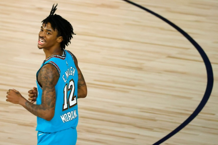 Memphis Grizzlies' Ja Morant reacts after being called for traveling against the Utah Jazz during the second half of an NBA basketball game Wednesday, Aug. 5, 2020, in Lake Buena Vista, Fla. (Kevin C. Cox/AP file)