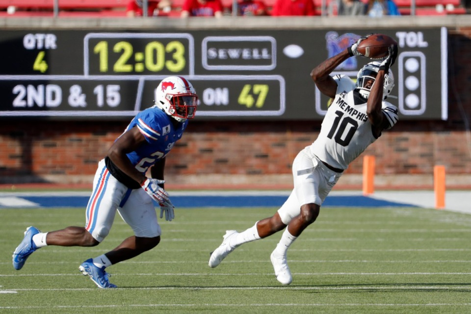 <strong>Memphis wide receiver Damonte Coxie (10) makes a reception in front SMU defensive back Brandon Stephens (23) during the second half of an NCAA college football game in Dallas, Saturday, Oct. 3, 2020.</strong> (Roger Steinman/AP)