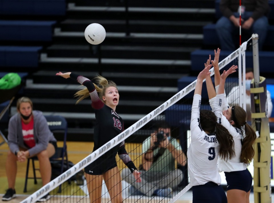 <strong>Collierville High School's Abbi Peterson (12) goes up for a spike during an Oct. 15, 2020, match against Arlington High School.</strong> (Patrick Lantrip/Daily Memphian)