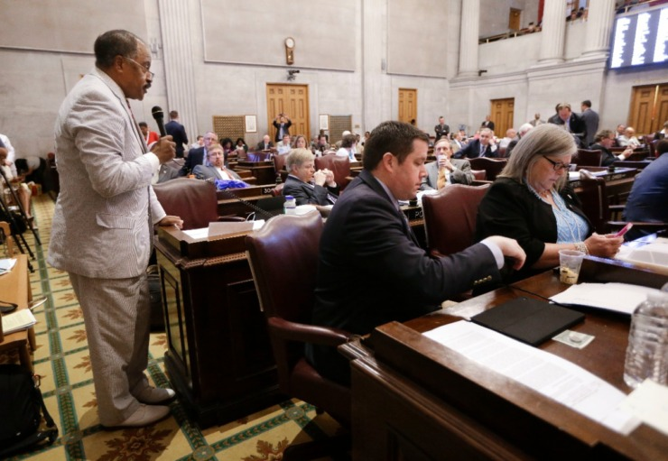 <strong>Rep. John DeBerry (standing, left) , speaks during a House debate in Nashville.</strong> (Mark Humphrey/AP file)
