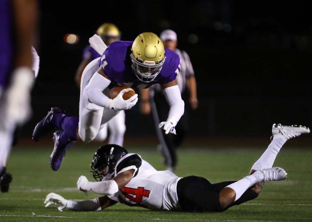 <strong>CBHS tight end Bryce Dalley (11) is brought down by a PURE defender on Oct. 16.</strong> (Patrick Lantrip/Daily Memphian)