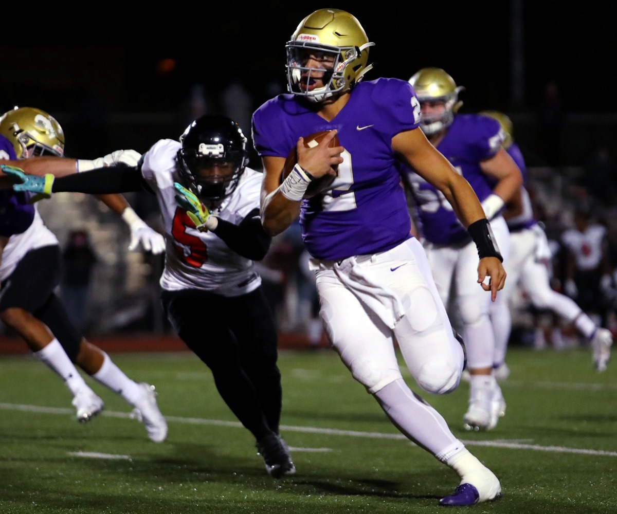 <strong>CBHS quarterback Ashton Strother (with ball) is pursued by PURE defenders on Oct. 16,.</strong> (Patrick Lantrip/Daily Memphian)