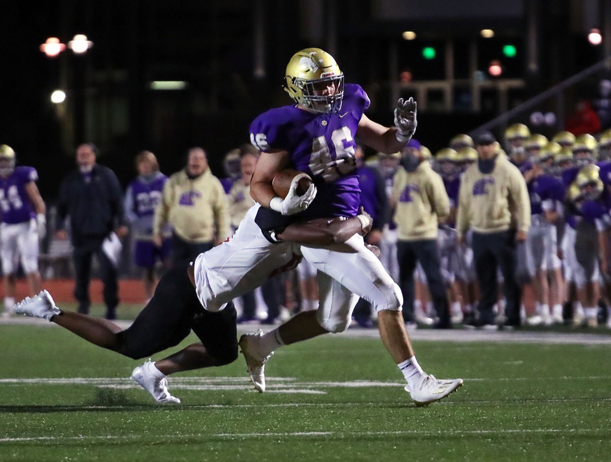 <strong>CBHS fullback Hunter Higdon (46) is tackled by a PURE defender on Oct. 16.</strong> (Patrick Lantrip/Daily Memphian)