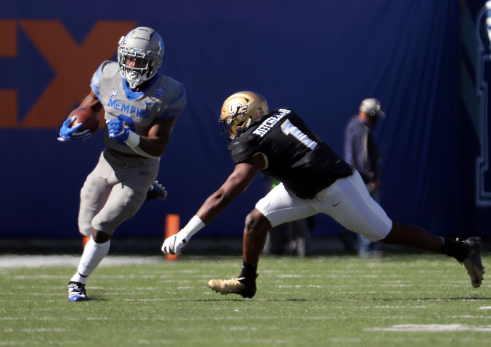 <strong>University of Memphis running back Rodrigues Clark (2) dodges a defender during an Oct. 17, 2020 game against the University of Central Florida at Liberty Bowl Memorial Stadium in Memphis, Tennessee.</strong> (Patrick Lantrip/Daily Memphian)&nbsp;