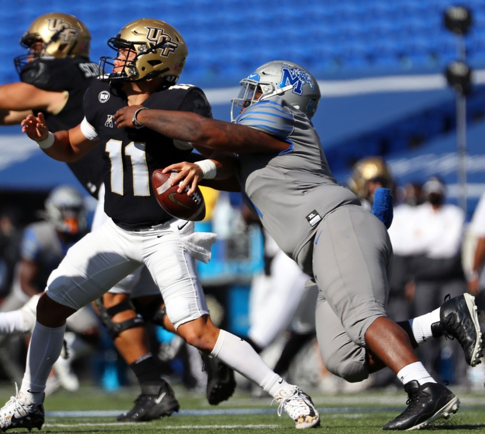 <strong>University of Memphis defensive lineman O'Bryan Goodson (1) drags down University of Central Florida quarterback Dillon Gabriel (11) during an Oct. 17, 2020 game at Liberty Bowl Memorial Stadium in Memphis.</strong> (Patrick Lantrip/Daily Memphian)