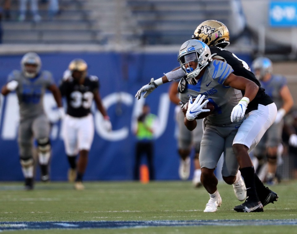 <strong>University of Memphis wide receiver Calvin Austin III (4) come up after a big catch against University of Central Florida during an Oct. 17, 2020 game at Liberty Bowl Memorial Stadium.</strong> (Patrick Lantrip/Daily Memphian)